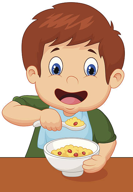 Child in a green shirt eating cereal.